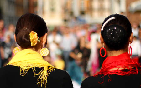 heads of two women with very hairstyle and a yellow and red scarf during a show Stock Photo - 22412282