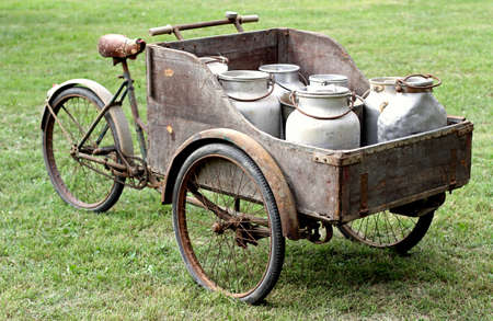 milkman: rusty old bikes of ancient milkman with aluminium drum