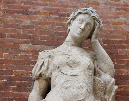 statue with headaches with red brick  photo