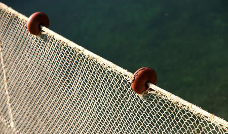 intact: fishing nets intact without fish but with some floats on the edge