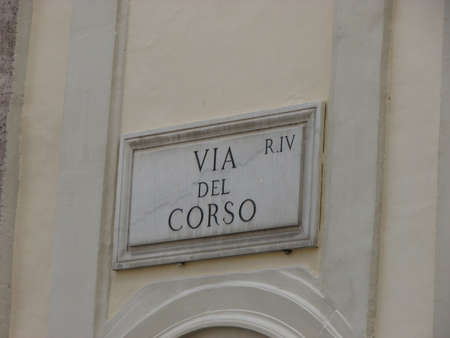 indication: marble road sign with an indication of the Via del Corso in Rome Italy