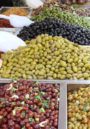ragusa: tasty seasoned olives for sale at vegetable market directly from producer to consumer