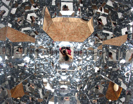 photographer with a thousand mirrors while running a self-timer reflected a thousand times photo