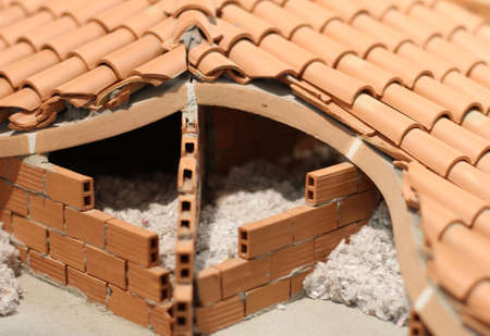rockwool: Attic insulation with the insulating material of the House made of terracotta brick red Stock Photo