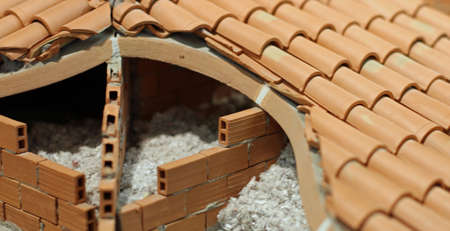 Attic Insulation With The Insulating Material Of The House Made Of  Terracotta Brick Stock Photo