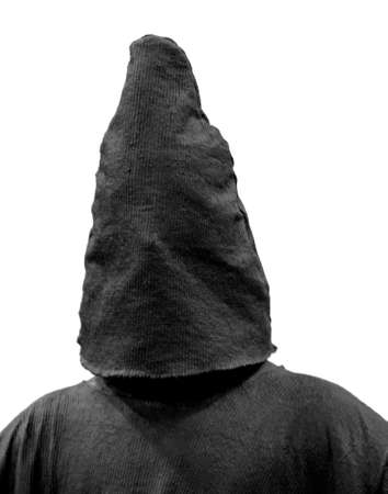 spooky hooded man with a medieval executioner s mask photo