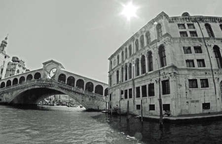 rialto bridge in Venice with the canal and boats 2 photo