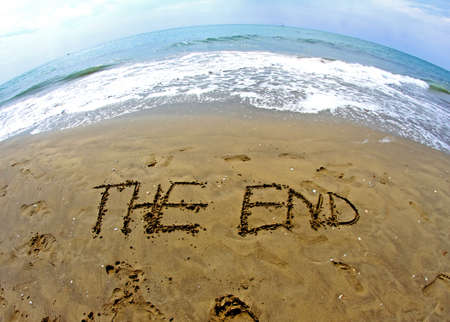 fantastic writing THE END on the sea beach with fisheye lens photo