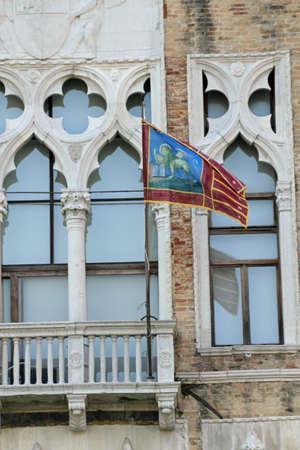 headquarter: flag of veneto region in headquarter of REGIONE VENETO in a former Palace in Venice