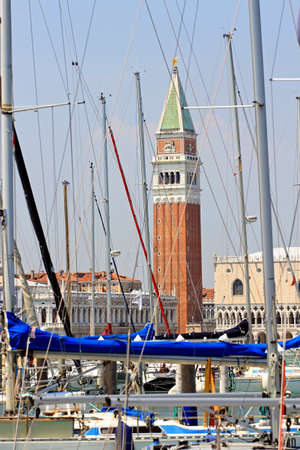 bell tower of St. Mark in the midst of so many masters of trees yatch and ships moored in the port Stock Photo - 22557617
