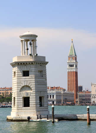 old lighthouse on the island of San Giorgio in Venice and St. Mark's Bell Tower in the background Stock Photo - 22542310