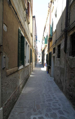 cramped: narrow calle of Venice with the high houses on both sides of the street