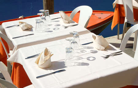 set the table an elegant Italian restaurant on the Canal in Venice photo