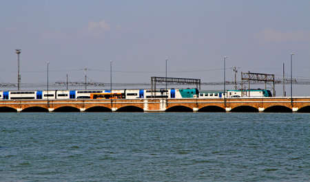 the mainland: trains and buses over the ponte della libertà that connects the island of Venice to the Mainland and the city of Mestre