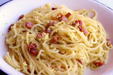 spaghetti carbonara with Bacon egg and Parmesan in a typical Italian dish photo