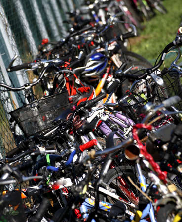 saddles and handlebars of bicycles of students in a school park
