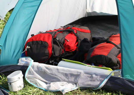 two backpacks in the tent and a aluminum lunchbox photo