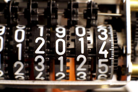 numerator: counter with the year 2014 in the numerator measuring meter Stock Photo