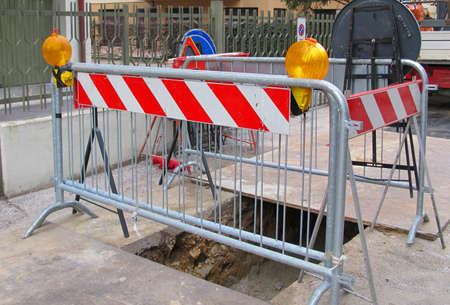 fiber optic lamp: road excavation for the laying of fibre optics in the street