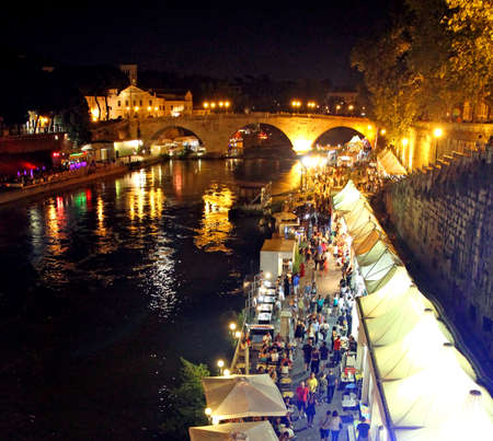 Lungotevere in Rome with night scenes and many people among the trendy bars