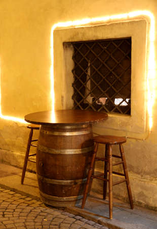 repurpose: coffee table of a bar made from an upside-down in a small barrel of a small medieval village