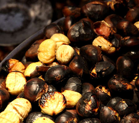 resale: tasty roasted chestnuts cooked over flame ready for sale