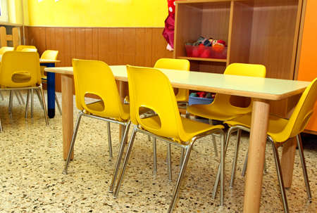 particular of a classroom in a kindergarten with little yellow chairs for the children