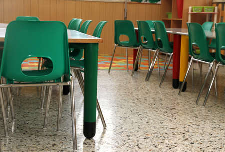 particular of a classroom in a kindergarten with little green chairs for the children