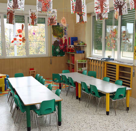 class of a nursery with drawings of children hanging from the ceiling