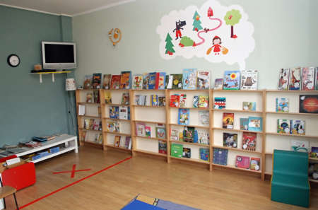 nursery room: library with many books of a nursery for children