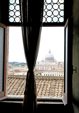st  peter s square: look stolen of the majestic dome of St. Peters basilica seen from a window with the curtains drawn Stock Photo