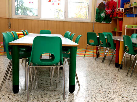 particular of a classroom in a kindergarten with little green chairs photo