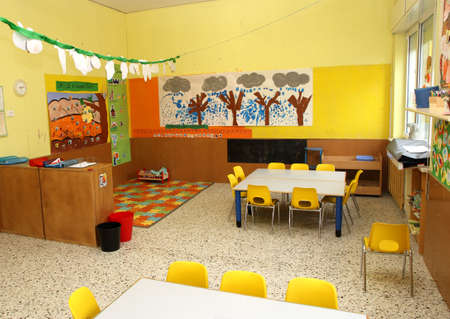 classroom in a kindergarten with little chairs for the children photo