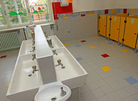 small bathrooms of children in a nursery and very low sinks photo