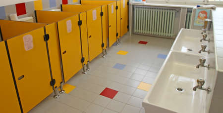 small bathrooms of children in a nursery and very low sinks for the children photo
