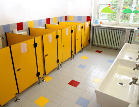 small bathrooms of children in a kindergarten  and very low sinks photo