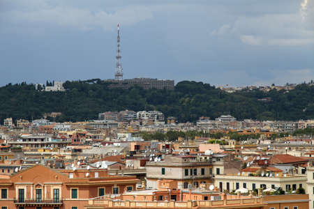 dwell: panorama of the city of Rome seen from Castel San Angelo with the roofs nd Mario Mountain Stock Photo