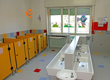 small sinks for cleaning of infants within a nursery Banco de Imagens