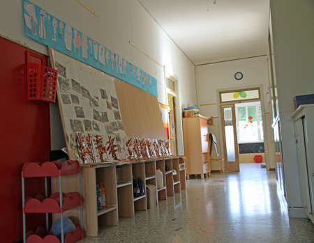 long corridor with drawings in a private preschool nursery photo