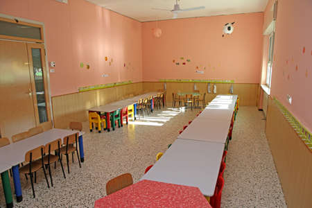 canteen benches inside a kindergarten child nursery for young children photo