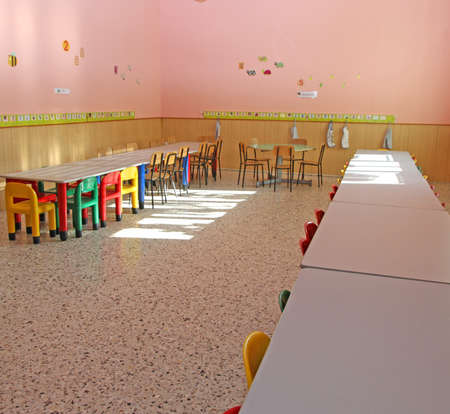 small colored chairs and benches of the nursery canteen for young children photo