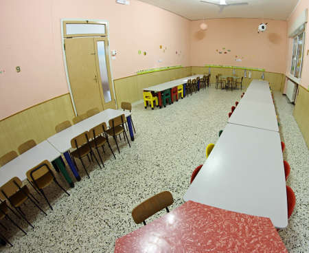 refectory of the nursery school with chairs  photographed with a fisheye lens photo