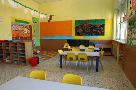 kindergarten class with yellow chairs in the morning