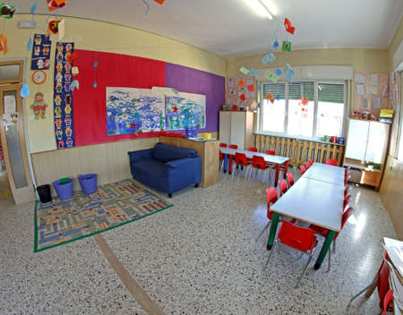 painting workshop of a kindergarten where children learn to paint with tempera colours photo