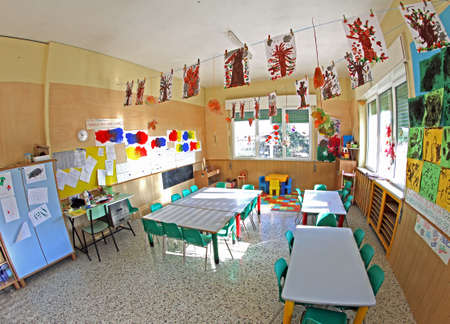 classroom of children with many drawings of trees hanging photo