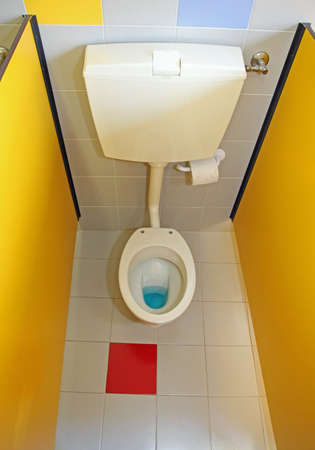 toilet bowl water very small for children with yellow walls in a kindergarten photo