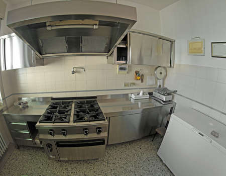 restaurateur: stainless steel industrial kitchen for preparing meals with a big freezer for food preservation