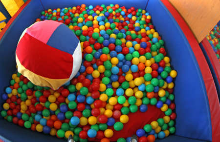 swimming pool with plenty of colorful plastic balls photo