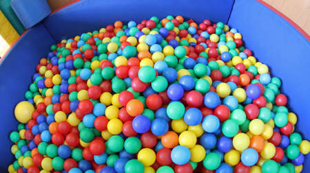 large swimming pool with plenty of colorful plastic balls photo