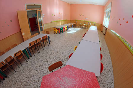 refectory benches in a kindergarten child nursery for young children Stock Photo